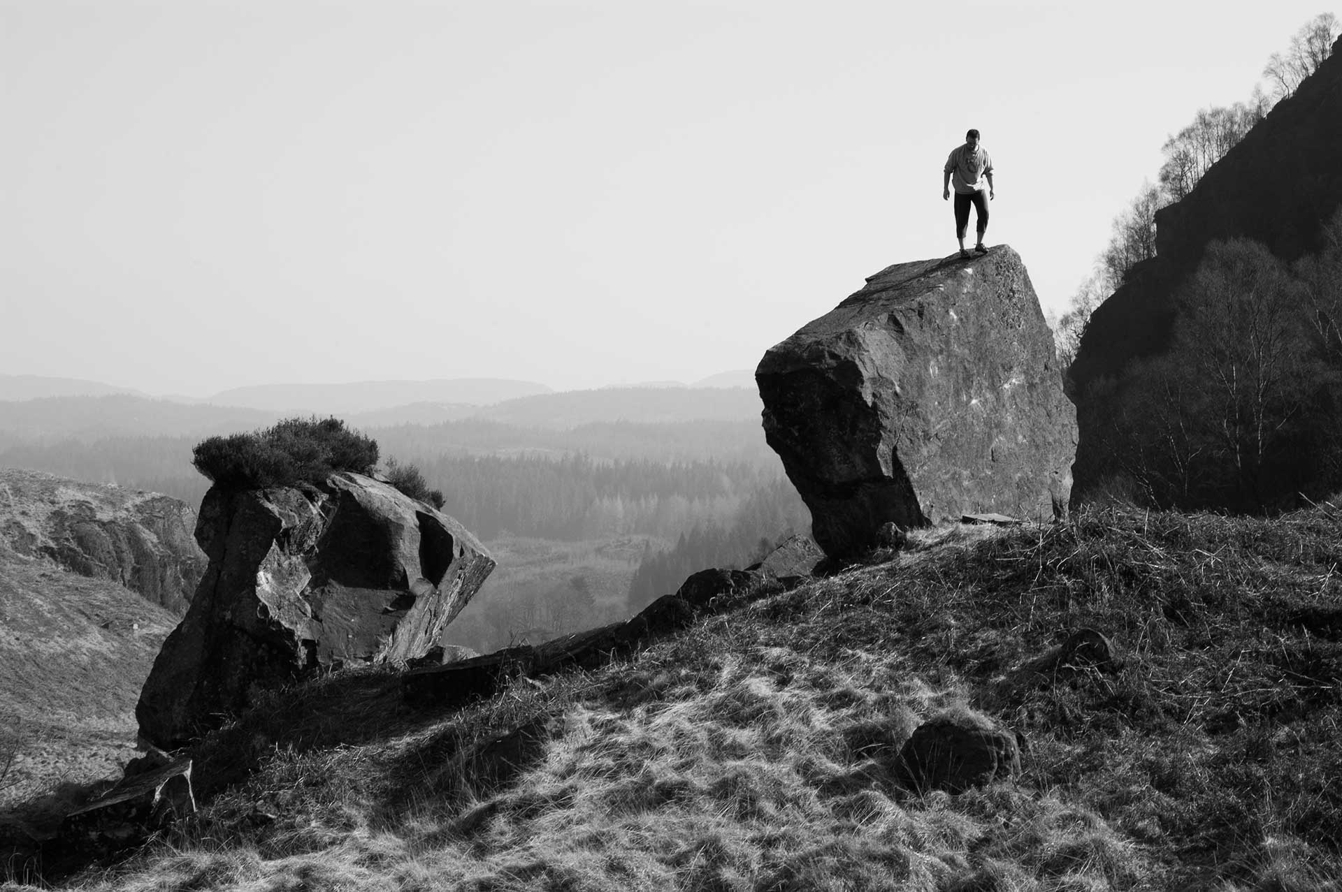 John atop the Jawa boulder at Loch Katrine, also the cover photo for our book Stone Country